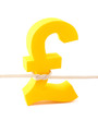 Golden pound symbol tied with rope