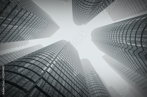 Reflective skyscrapers, business office buildings in fog.