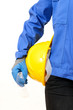 Yellow hardhat under arm against white background