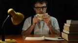 Happy nerd man counting money at night