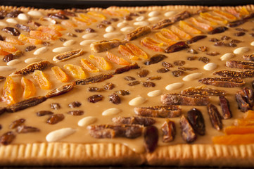 close up of cake with almonds, figs, apricots, nuts