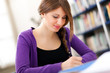 Young female student in a library