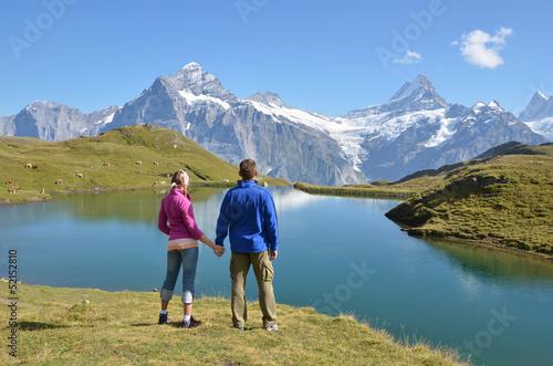 Travelers enjoying Alpine panorama. Jungfrau region, Switzerland