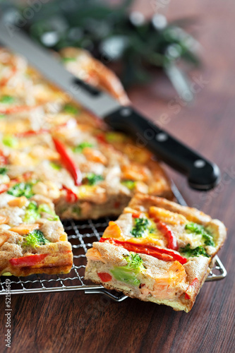 Pie with salmon, red pepper and broccoli, selective focus