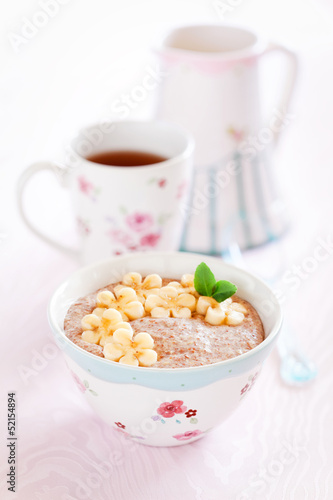 Oatmeal porridge with banana and flax seed, selective focus