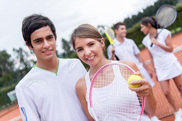Tennis couple playing doubles
