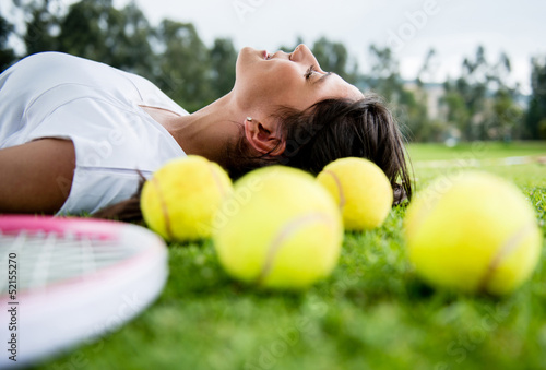 Tennis player daydreaming outdoors