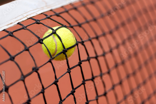 Tennis ball bouncing on the net