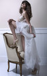 Young beautiful bride with high-heel schoes