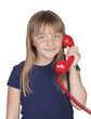 Adorable girl with a red phone