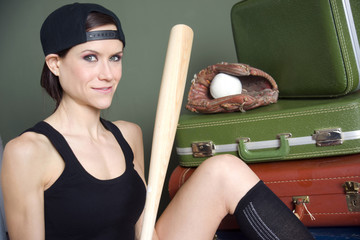 Atractive Female Baseball Player Sits Bat Gear Glove
