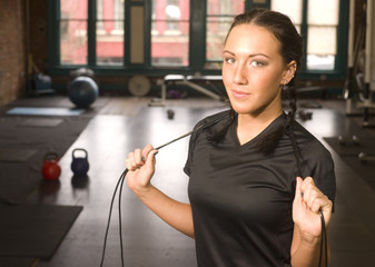 Healthy Fit Woman Stands after Rope Work at Fitness Boot Camp