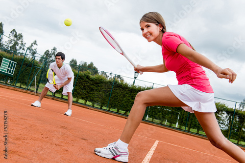 Woman playing doubles in tennis