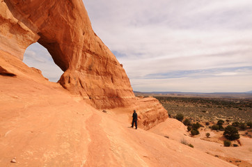 Middle-Aged Man Hiking Near Looking Glass Arch