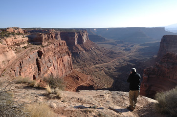 Man Taking a Photo of Shafer Trail Road in Canyonlands Natl Park