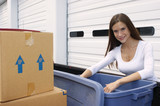 Moving Day with Smiling Woman Unpacking Truck Load of Stuff