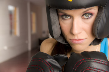 Serious Female Boxer Looks Right at Camera in Close up