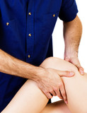 Close-up of a therapist giving a knee massage