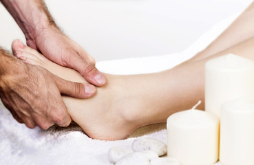 Physiotherapist giving a foot massage