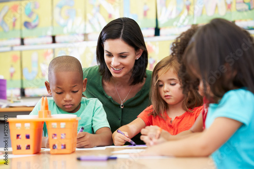 Group Of Elementary Age Children In Art Class With Teacher - 52157403