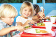 Leinwanddruck Bild - Elementary Pupils Enjoying Healthy Lunch In Cafeteria
