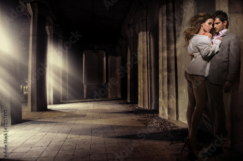 Great shot of sensual couple in antique area