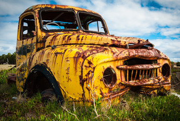 Yellow pickup truck rusty wreck