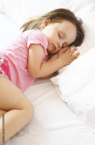 Little girl sleeping peacefully in bed