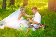 couple picnic sunlight wedding in forest glade, bride groom flow