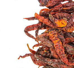 A group of dried chilly over white background