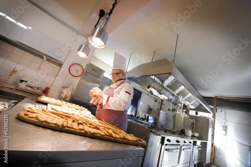 Female Chef Kneading Dough