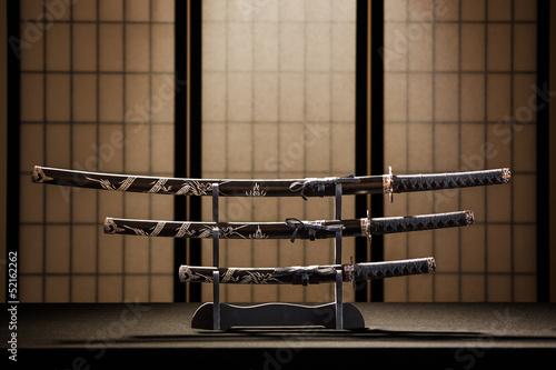 Foto op Plexiglas Japan Katana, wakizashi and tanto on stand in a room
