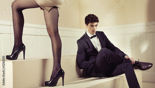 Glad man looking at shapely legs of his girlfriend