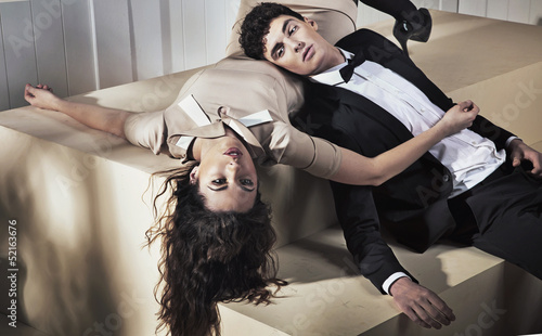 Exhausted young couple resting after banquet