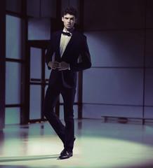 Handosme slim guy wearing black suit