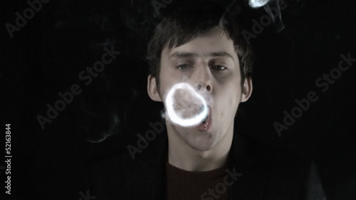 Man blowing smoke rings