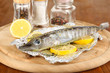 Fish in foil with herbs and lemon
