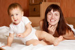 Happy mother with  baby   n interior