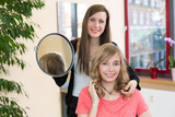 hairstylist shows client her new haircut poster