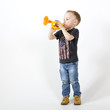 Boy playing toy trumpet