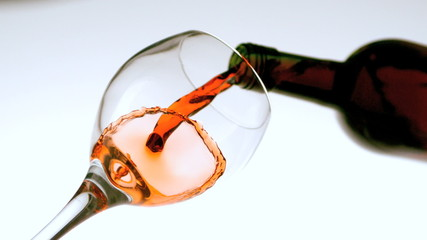 Red wine pouring into a glass low angle view