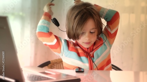 girl listening to the music on her headphones