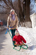 mother with toddler on sled