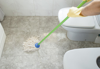 scrubbing the bathroom floor