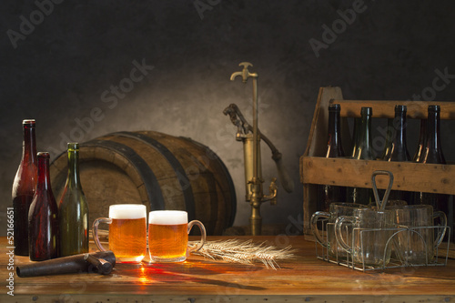 beer still life on the table with old  beer kegs tap