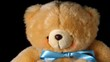 Teddy bear falling on black background close up