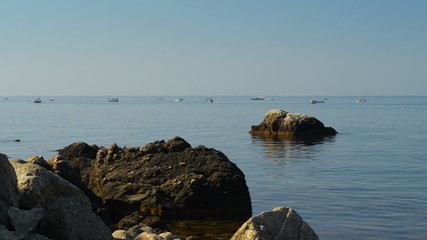 Beautiful seascape and a lot of little boats that sail