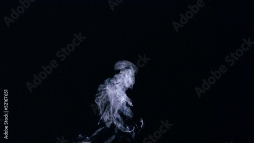 White smoke rising on black background