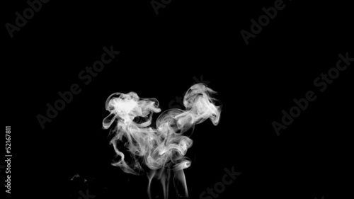 Rising puff of white smoke on black background