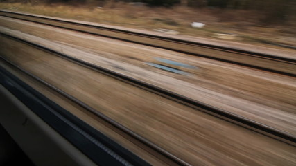 Travelling by train in England. View of multiple tracks.